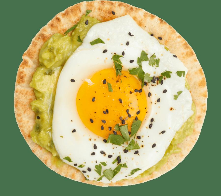 Egg and guacamole on a pita