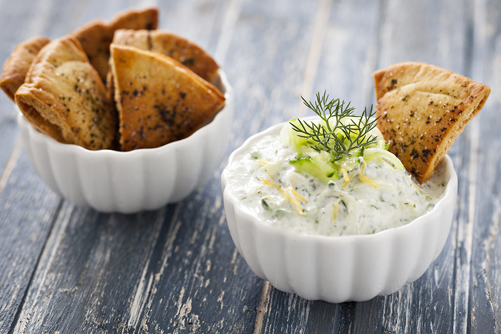 Pita chips in a bowl and dip.